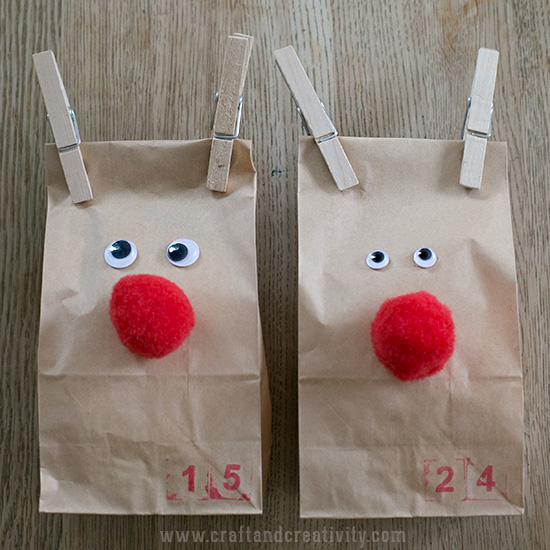 two brown bags decorated like reindeer